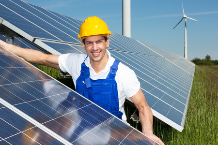 installer: Photovoltaic engineer or installer installing solar panels