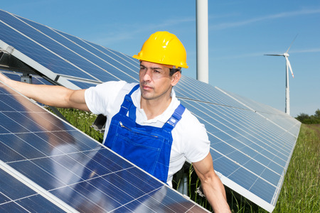 human energy: Photovoltaic engineer or installer installing solar panels