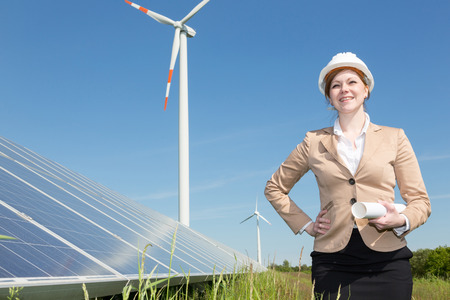 solar wind: architect or engineer  posing with wind turbine and solar panels