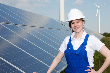 installer: A engineer or installer posing with solar panels