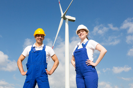 wind energy: Two engineers or installers posing in front of wind energy turbine Stock Photo