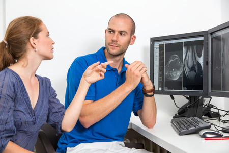 computed: Radiologist councelling a patient using images from x ray computed tomograpy or MRI