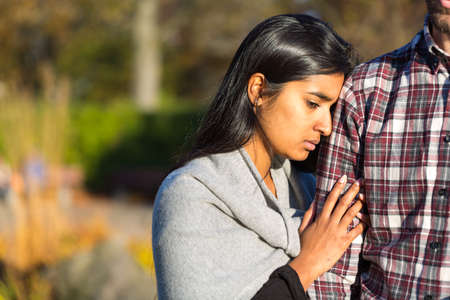 holding in arm: Woman holding arm of her rejecting partner Stock Photo
