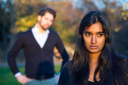 indian men: Couple after a fight in a park Stock Photo