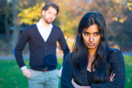 relationship breakup: Couple after a fight in a park Stock Photo