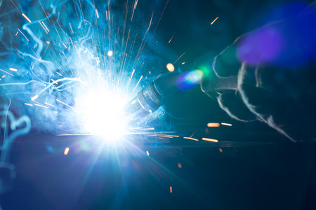 welding metal: Closeup of welding metal with arc, sparks and torch Stock Photo