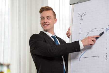 presenting: Man giving presentation on flip chart at meeting or congress
