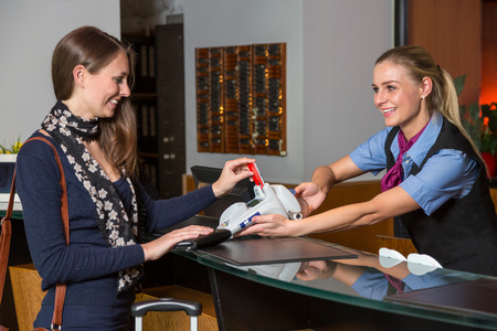 receptionist: Guest in a hotel paying with credit card at reception