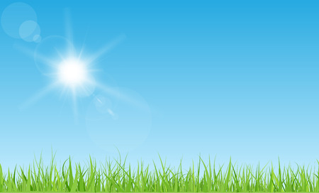 green and white: Sun with rays and flares on blue sky. Green grass lawn.