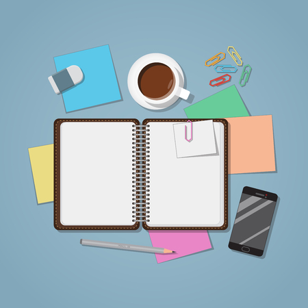 Opened notebook with papers and stickers. Cup of coffee with smartphone and clips.