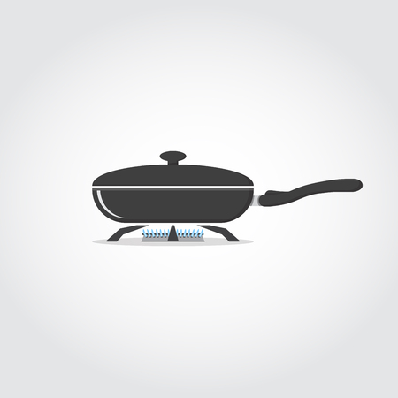Frying black pan on stove with blue gas flame.