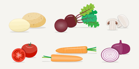 A set of fresh juicy sunny vegetables. Potatoes, beets, tomatoes, carrots, onions and mushrooms. Whole and cut into half. Internal cut of products.