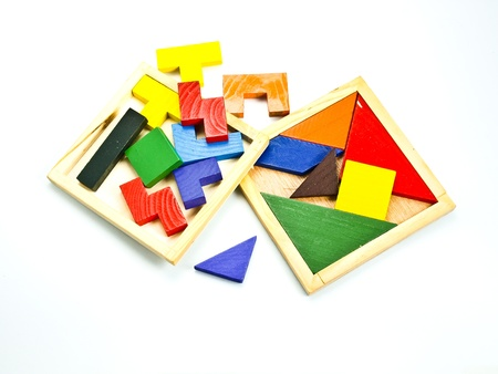 colorful wooden toy puzzle in red, yellow, green and blue, isolated on white