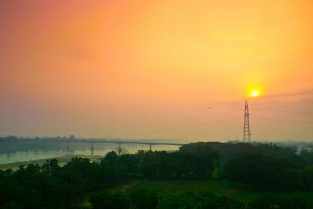 sunrise behide Electric high voltage power post