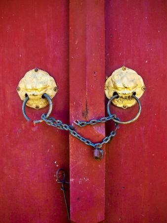 old red door in temple of Thailand