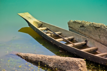 The old wooden boat in the river photo
