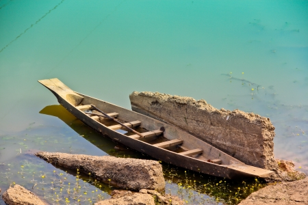 The old wooden boat in the river Stock Photo