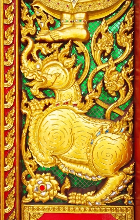 detail form decoration of temple of Thailand with wood engraving in Thai style at the temple gate in Thailand  Native Thai style and this is Traditional and generic style in Thailand   no any trademark or restrict matter in this photo