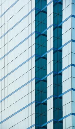 modern blue glass wall of of modern office building