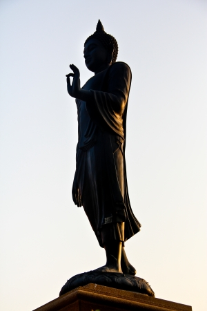 Silhouette of stand buddha statue, Thailand