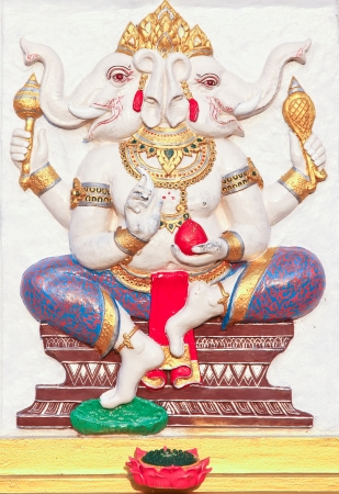 ganesha statue , God Named Triaksara Ganapati at temple in thailand ;The conviction will be used hand to apply to the Lord for get the wishes  photo