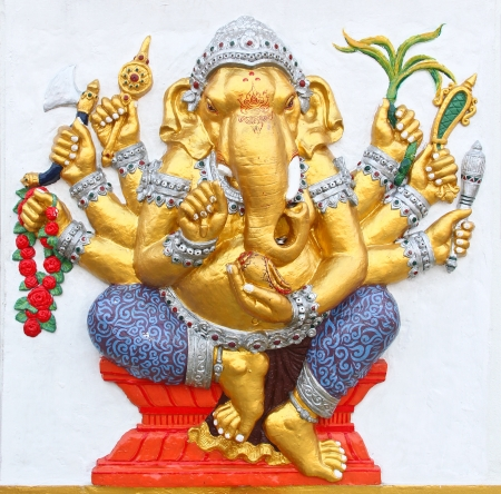 indian animal: ganesha statue , God Named Triaksara Ganapati at temple in thailand ;The conviction will be used hand to apply to the Lord for get the wishes  Stock Photo
