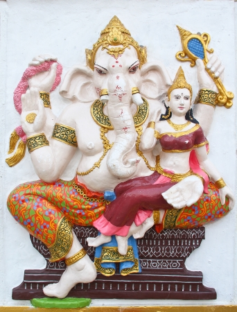 ganesha statue , God Named Triaksara Ganapati at temple in thailand ;The conviction will be used hand to apply to the Lord for get the wishes  Stock Photo