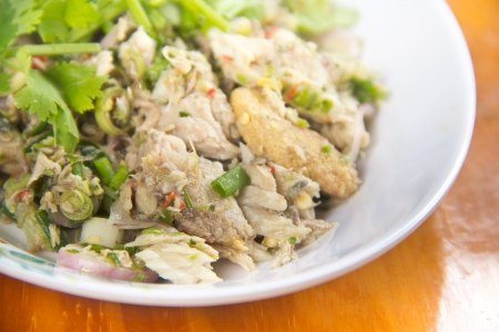 Thai dressed spicy salad with tuna, green herbs and photo