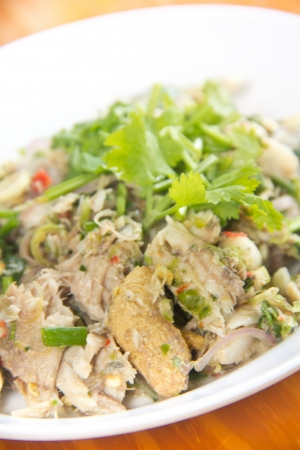 Thai dressed spicy salad with tuna, green herbs and