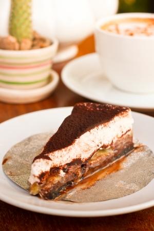 chocolate cake - chocolate cake with banana and a cup of coffee on table