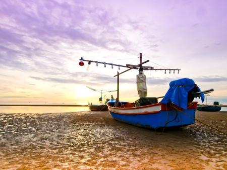fishing boats at sea  At sunrise Hua Hin Thailand Stock Photo