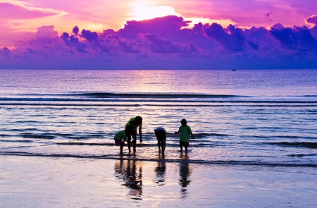 family play on the beach in sunrise background at Hua Hin beach, Thailand  Stock Photo