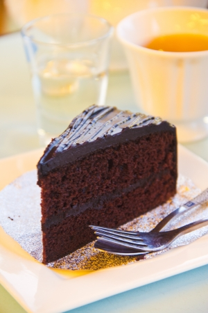 chocolate cake - chocolate cake and a cup of tea on table