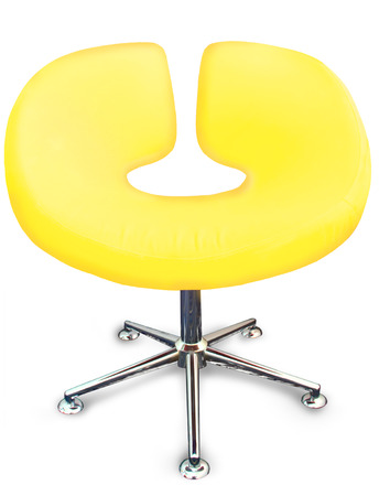 Modern chair in metal and yellow fabric Stock Photo