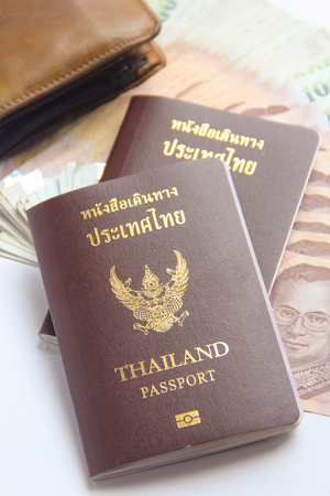 two Thailand passports and Thai  banknote