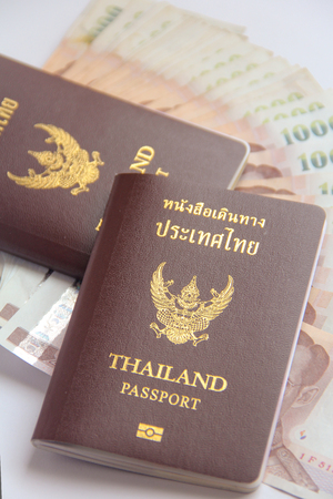 holidays vacancy: two Thailand passports and Thai  banknote