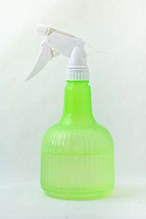 Green spray bottle  on white background