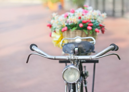 Flower fabric ,Fake textile flower  in basket on Vintage  bicycle