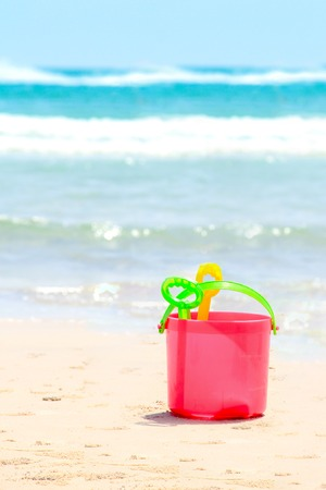 a bucket and sand toys for the children play time either on vacation, at the beach
