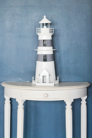 Model wooden lighthouse white color