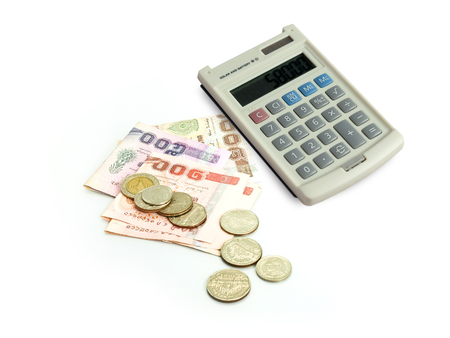 Calculator ,Thai banknote and coin on white background