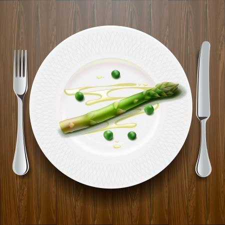 Frischer grüner Spargel auf dem Teller