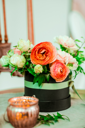 Flower decoration over a brown chair. Stock Photo