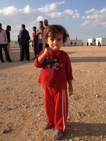 syrian: One of the Syrian refugees child at Jordans Zaatarii refugees camp during 2012  Eid Al-Adha celebration.