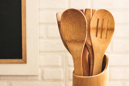 kitchen ware: Wooden kitchen ware in the kitchen Stock Photo