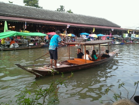 amphawa: Traditional wooden boat with paddle at Amphawa floating market, Thailand. Stock Photo