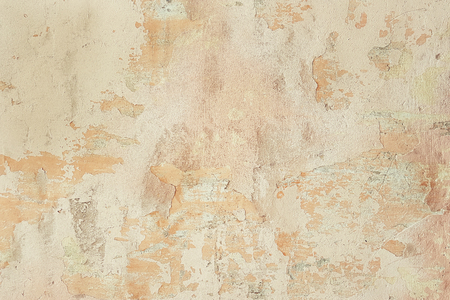 Vintage surface of old shabby wall with falling off plaster, beige-brown shades, background, texture