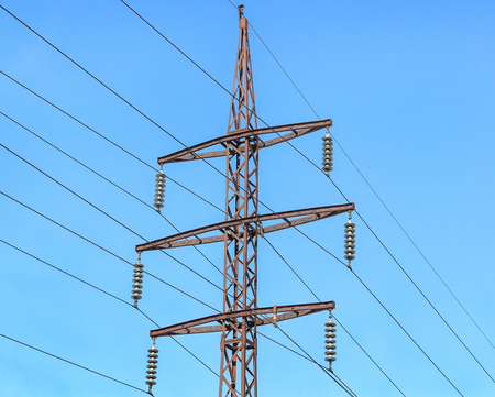 Metal support (elektroopora) of overhead power lines against a blue sky. Stock Photo