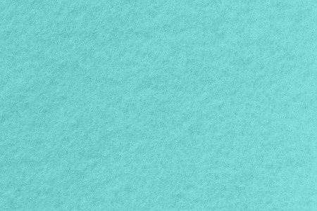 Surface of blue-colored felt close-up. Azure background, seamless texture.