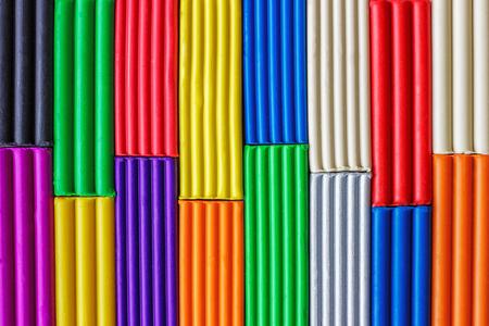 multicolored plasticine background, texture. Plasticine for modeling and development of imagination, fine motor skills.